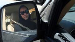 A lady in a car
