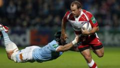 "Gloucester""s wing James Simpson-Daniel (R) tries to break a tackle from USA Perpignan""s No.8 Luke Narraway"