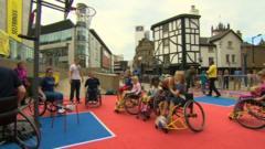 Children in wheelchair playing basketball