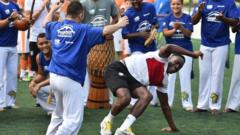 Players dancing capoeira