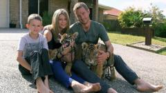 Giles Clark with wife Kerri, son Kynan and tiger cubs