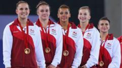 England's gymnastics women's team final winners wearing medals