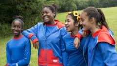 The new Girlguide uniform - blue tshirts and jumpers with red trim.