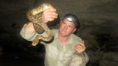Steve backshall holding a snake