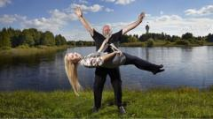 Man lifts woman with his beard