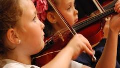 Girls playing violin