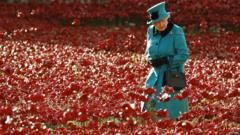 The Queen looking at the ceramic poppies