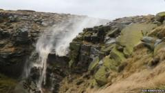 Kinder Downfall is blown backwards by powerful winds