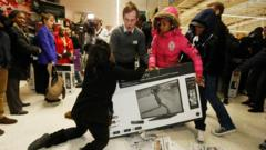 Shoppers wrestle over a TV
