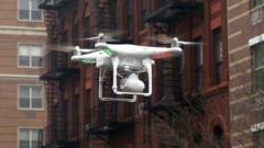A drone flying down a street