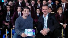 Ricky and a group of school kids ask Chris Hadfield questions