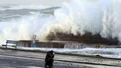 Man takes picture as huge wave breaks in Portrush