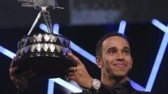 Lewis Hamilton holding SPOTY trophy