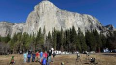 Spectators watch climbers on El Capitan