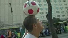 Man in Mexico balancing a football on his head for 57 days.