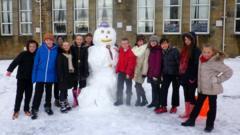 Snowman with schoolchildren