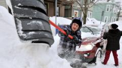 Rich and Kathy Melvin shovel out their car in front of their house in Somerville, Mass.