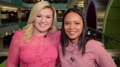 Singer Kelly Clarkson with news reporter Leah Boleto