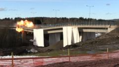 An explosion on a bridge which is being demolished