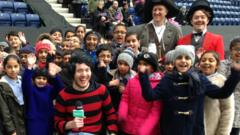 Martin Dougan with children on World Book Day