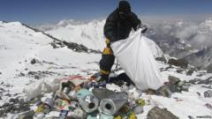 A Sherpa collects rubbish on Mount Everest