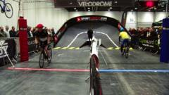 People cycling inside velodrome