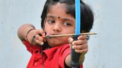 Two-year-old Indian archer Dolly Shivani Cherukuri takes aim during a world record target attempt at The Volga Archery Academy in Vijayawada some 250kms south-east of Hyderabad on March 24, 2015
