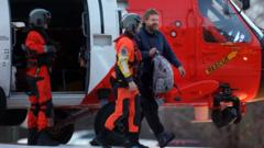 Louis Jordan walking out of helicopter