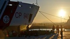 Recused migrants wait on a dockside