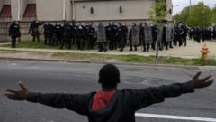 A protestor gestures to police