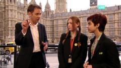 BBC reporter Ross Hawkins with children