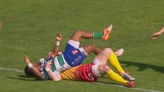 Henry Senioli is tackled by Scott Williams
