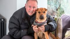 Ian Russell with the dog his rescued dog, Kai