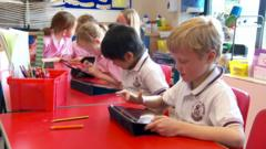 Children playing with their tablets