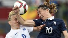 England's defender Laura Bassett vies with France's midfielder Camille Abily during a Group F match at the 2015 FIFA Women's World Cup between France and England at Moncton Stadium in Moncton, New Brunswick