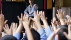 School kids hold up hands
