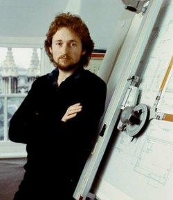 Rick Dickinson stands next to drawing board used to design the ZX Spectrum