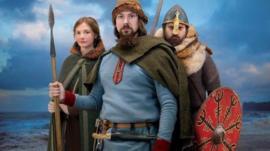 People in Viking costumes
