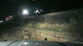 A Utah officer is being hailed a hero after rescuing a driver who crashed onto the tracks.