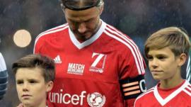 David Beckham with his sons at the Unicef charity match