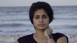Natasha Noel on a beach in India