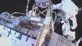 Tim has a camera mounted on the helmet of his spacesuit which is sending video of the repairs he is doing back to earth.