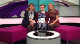 Jenny with guests on sofa