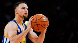 Golden State Warriors guard Stephen Curry competes in the three point NBA all-star skills competition in Toronto on Saturday, Feb. 13, 2016.