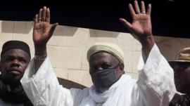 """Imam Mahmoud Dicko greets his supporters during a protest demanding the resignation of Mali""""s President Ibrahim Boubacar Keita at Independence Square in Bamako, Mali June 19, 2020."""
