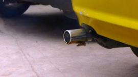 Graviky's Kaalink device attached to a car exhaust
