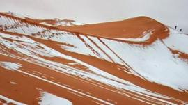 Snow is seen on the sand dunes of the Sahara