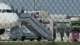 Passengers leave plane