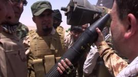 Shia militia fighters in Baghdad show off weapons they say were bought from Iran