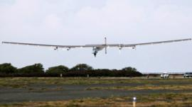 The Solar Impulse 2 airplane, piloted by Andre Borschberg, lands at Kalaeloa Airport in Kapolei, Hawaii, after flying non-stop from Nagoya, Japan,